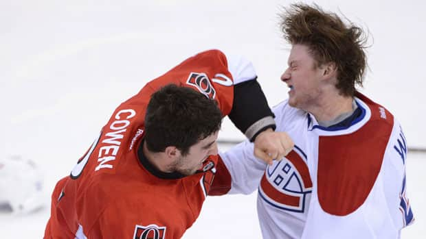 Senators defenceman Jared Cowen, left, and Montreal Canadiens winger Ryan White exchange blows during the third period of Game 3 Sunday night in Ottawa. (Sean Kilpatrick/Canadian Press)