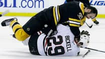 Boston Bruins defenceman Zdeno Chara (33) will continue battling with Chicago Blackhawks left wing Bryan Bickell in Game 5 on Saturday night in Chicago. (Elise Amendola/Associated Press)