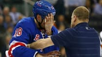 New York Rangers defenceman Marc Staal is helped off the ice after he was hit in the face with a puck against the Philadelphia Flyers on March 5. (Elsa/Getty Images)