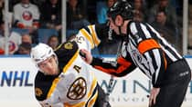 Patrice Bergeron, left, of the Bruins has earned plaudits throughout the Stanley Cup playoffs for his ability to win key faceoffs. (Paul Bereswill/Getty Images)