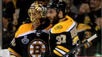 Bruins forward Patrice Bergeron (37) celebrates with goalie Tuukka Rask after Boston defeated the Chicago Blackhawks in Game 3 Monday night to take a 2-1 series lead in the Stanley Cup final. (Harry How/Getty Images)