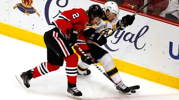 Even with great conditioning, the Stanley Cup final has taken its toll on players like Blackhawks defenceman Duncan Keith, left, and Bruins forward Brad Marchand, right, after two games. (Gregory Shamus/Getty Images)