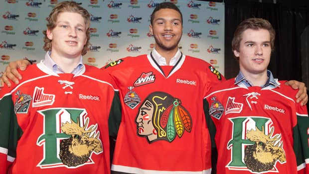 Seth Jones, middle, Nathan MacKinnon, left, and Jonathan Drouin have been ranked 1-2-3 respectively by NHL Central Scouting. (Liam Richards/Canadian Press)