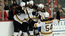 Daniel Paille, left, celebrates his overtime-winning goal with some of his Boston Bruins teammates in Game 2 against the Chicago Blackhawks Saturday night. (Jonathan Daniel/Getty Images)