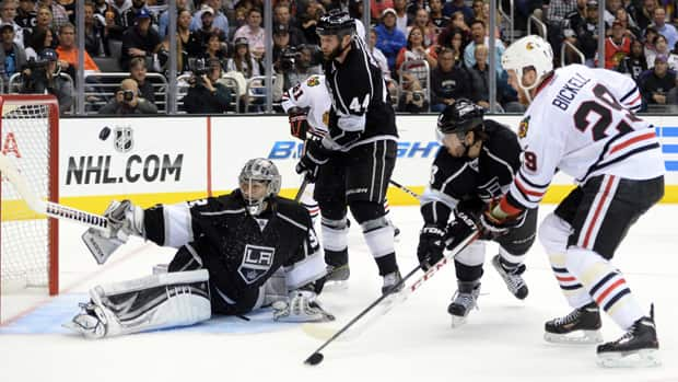 Kings goaltender Jonathan Quick (32) robs Chicago Blackahwks winger Bryan Bickell (29) in Game 3 Tuesday night in Los Angeles. (Harry How/Getty Images)