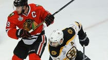 Boston Bruins centre Patrice Bergeron (37) and Chicago Blackhawks counterpart Jonathan Toews (19) both suffered injuries in Game 5 on Saturday night. (Charles Rex Arbogast/Associated Press)