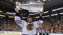 Chicago Blackhawks captain Jonathan Toews celebrates with the Stanley Cup after his team defeated the Boston Bruins Monday night. (Brian Snyder/Reuters)