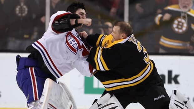 Tim Thomas, right, never seems to back down from physical play, which led to fisticuffs here with Montreal's Carey Price, left. (File/Getty Images)
