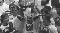 Bryan Trottier, at centre with the Stanley Cup, won the trophy six times as a player and another as an assistant coach. (File/Associated Press)
