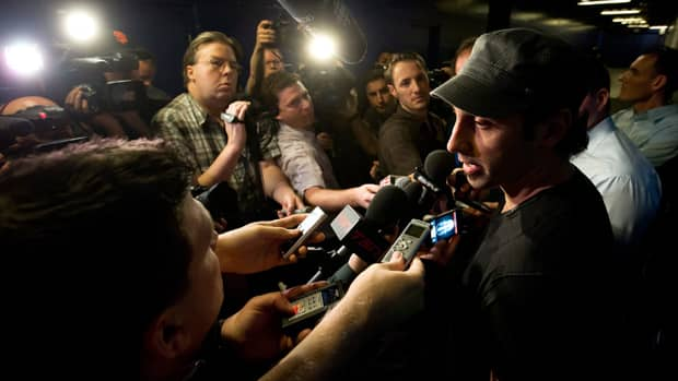 In this file photo from May 9, 2013, Roberto Luongo speaks to the media after being eliminated from the Stanley Cup playoffs. The goalie said he was 'floored' when the Vancouver Canucks decided to keep him as their goalie and instead t