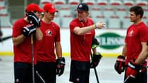 Left to right, Patrick Sharp, Sidney Crosby, head coach Mike Babcock and Chris Kunitz during a ball hockey training session at the Canadian national men's team orientation camp in Calgary, Alta., Monday, Aug. 26, 2013. (Jeff McIntosh/The Canadian Press)