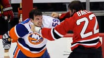 New York Islanders forward Brett Gallant, left, fights with New Jersey Devils winger Krys Barch during the third period on Thursday in Newark, N.J. (Bill Kostroun/Associated Press)