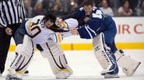 Toronto Maple Leafs goaltender Jonathan Bernier, right, hammers Buffalo Sabres netminder Ryan Miller during a third-period brawl in Toronto on Sunday. (Frank Gunn/Canadian Press)