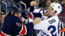 The Maple Leafs' Colton Orr, right, gets paid $925,000 US a season to fight. It's what he does, but Orr would also like to be known as a good checking forward who is good defensively and a leader. (Jim McIsaac/Getty Images)
