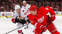 Detroit Red Wings forward Daniel Alfredsson, right, was held pointless in his first game against his former team, the Ottawa Senators. (Gregory Shamus/Getty Images)