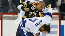 Jarome Iginla (12) of the Boston Bruins fights Radko Gudas (7) of the Tampa Bay Lightning in the second period during both teams' home opener Thursday. (Jared Wickerham/Getty Images)