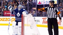 Toronto Maple Leafs goalie Jonathan Bernier, left, stares at referee  as he signals the goal for the Carolina Hurricanes on Thursday, Oct. 17, 2013. (Nathan Denette/The Canadian Press)