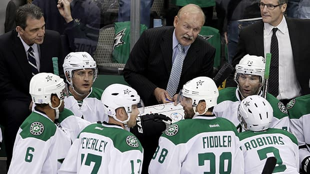Dallas Stars head coach Lindy Ruff gives instructions from the bench during a game against the Washington Capitals, Saturday, Oct. 5, 2013, in Dallas. (Tony Gutierrez/The Associated Press)