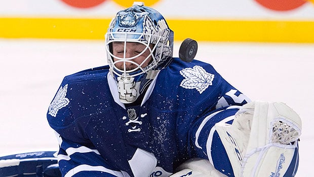 Solid goaltending by James Reimer and Jonathan Bernier, pictured here, and not their NHL-leading 50 giveaways, is the reason the Maple Leafs have a 3-0 record, writes CBCSports.ca's Mike Brophy. (Frank Gunn/Canadian Press)