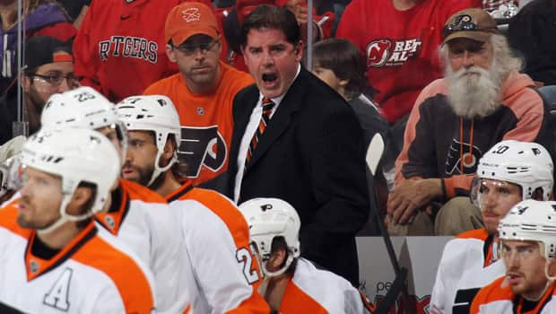 Peter Laviolette, middle, was fired Monday as head coach of the Philadelphia Flyers and replaced by assistant Craig Berube. (Bruce Bennett/Getty Images)