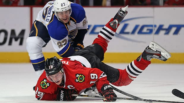 Alex Pietrangelo, top, and the Blues hope to get the upper hand on Jonathan Toews's Blackhawks when the Central Division rivals meet for the first time this season on Wednesday night. (Jonathan Daniel/Getty Images)