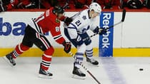 Chicago Blackhawks' Marian Hossa, left, works for the puck against Toronto Maple Leafs' James van Riemsdyk during the third period. (Andrew A. Nelles/The Associated Press)