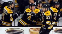Boston Bruins centre Patrice Bergeron (37) is congratulated by his teammates on the bench after scoring a goal during the second period against the Toronto Maple Leafs on Saturday. (Bob DeChiara/USA TODAY Sports/Reuters)