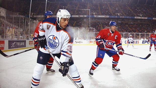 Right wing Fernando Pisani of the Edmonton Oilers, left, during the game against the Montreal Canadiens at the Heritage Classic on November 22, 2003 in Edmonton. (Dave Sandford/Getty Images)