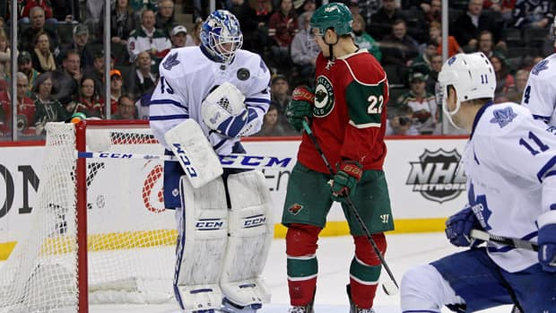 Toronto Maple Leafs goalie Jonathan Bernier (45) makes a save on Minnesota Wild forward Nino Niederreiter (22) during the third period at Xcel Energy Center. The Wild defeated the Maple Leafs 2-1 in a shootout Wednesday. (Brace Hemmelgarn/USA TODAY Sports/Reuters)