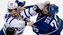 Toronto Maple Leafs forward Colton Orr, left, and Vancouver Canucks tough guy Tom Sestito duke it out during a game earlier this month. (Darryl Dyck/Canadian Press)