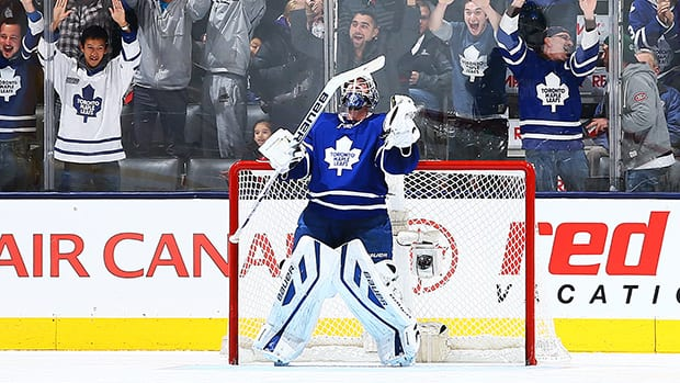 James Reimer of the Toronto Maple Leafs celebrates the shootout win against the Washington Capitals on November 23, 2013 in Toronto. (Abelimages/Getty Images)