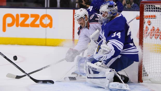 Blue Jackets forward Blake Comeau (14) pesters netminder James Reimer in a 6-0 victory over the Maple Leafs on Monday. (John E. Sokolowski/Reuters)