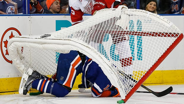 Oilers forward Jordan Eberle (14) gets hung up in the twine after charging the net in Saturday's 5-0 loss to the Red Wings. (Perry Nelson/Reuters)