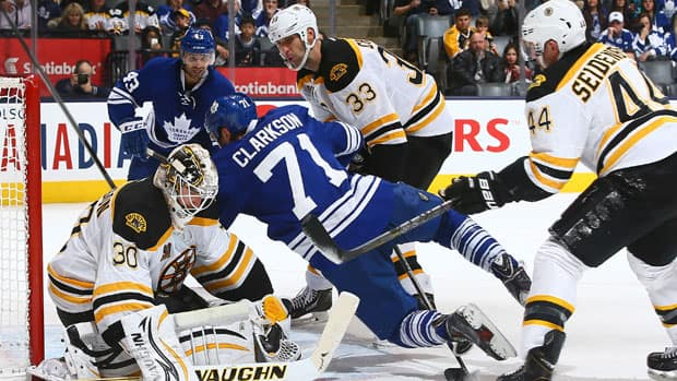 David Clarkson (71) of the Toronto Maple Leafs gets knocked into Chad Johnson (30) by Dennis Seidenberg (44) of the Boston Bruins at the Air Canada Centre Sunday in. (Abelimages/Getty Images)