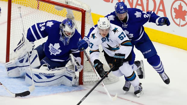 Toronto Maple Leafs goaltender James Reimer (34) and forward Peter Holland (24) defend against San Jose Sharks forward Tommy Wingels (57) during the third period of Toronto's 4-2 loss Tuesday. (John E. Sokolowski/USA TODAY Sports/Reuters)
