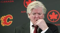 A loosely coiffed Brian Burke announced Thursday he's taking over the Flames' GM job on an interim basis following the firing of Jay Feaster. (Larry MacDougal/Canadian Press)