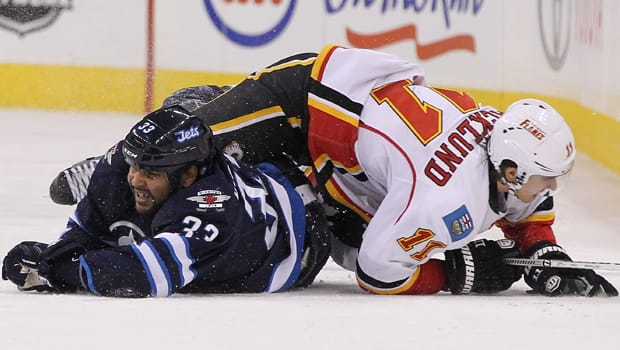 Dustin Byfuglien (33) and the Winnipeg Jets have struggled to take flight since switching to the superior Western Conference. (Marianne Helm/Getty Images)