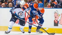 Oilers forward Taylor Hall (4) eludes defenceman Tobias Enstrom in Monday's 6-2 victory over the visiting Jets at Rexall Place. (Derek Leung/Getty Images)