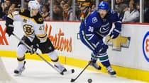 Jannik Hansen (36) of the Canucks is chased by Torey Krug (47) in a 6-2 victory over the Bruins at Rogers Arena on Dec. 14. (Derek Leung/Getty Images)