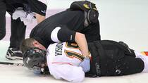A trainer tends to Joey Hishon (18) of the Owen Sound Attack after he was hit by Brayden McNabb, unseen, in a 5-0 Memorial Cup win over the Kootenay Ice at the Hershey Centre in Mississauga, Ont., on May 21, 2011. (Claus Andersen/Getty Images)
