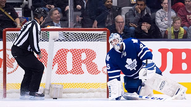 Toronto Maple Leafs goalie Jonathan Bernier reacts after mishandling the puck and allowing a New York Islanders goal during the second period Tuesday. (Nathan Denette/The Canadian Press)