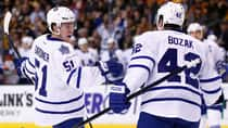 Jake Gardiner (51) of the Toronto Maple Leafs celebrates his goal with teammate Tyler Bozak (42) in the second period against the Boston Bruins on Tuesday. (Jared Wickerham/Getty Images)