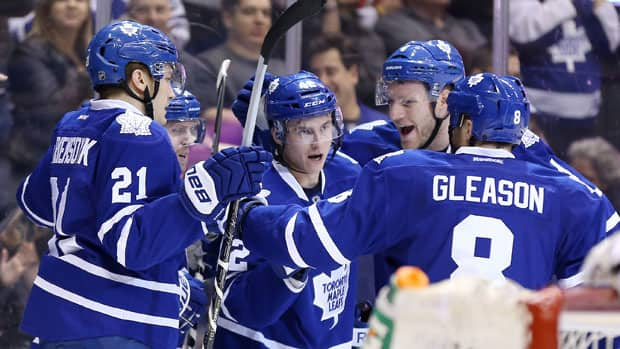 Toronto Maple Leafs centre Tyler Bozak (42) celebrates his goal with left wing James van Riemsdyk (21), right wing Phil Kessel (81) and defencemen Cody Franson (4) and Tim Gleason (8) against the New Jersey Devils at Air Canada Centre Sunday. (Tom Szczerbowski/USA TODAY Sports/Reuters)