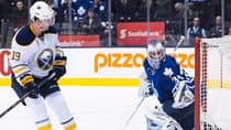 Toronto Maple Leafs goalie James Reimer, right, makes a save on Buffalo Sabres forward Cody Hodgson during the shootout Wednesday. Toronto defeated Buffalo 4-3.(Nathan Denette/Canadian Press)
