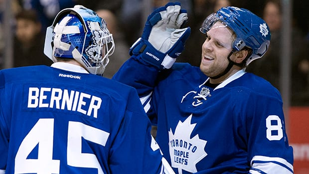 Toronto Maple Leafs goaltender Jonathan Bernier, left, and Phil Kessel celebrate after defeating the Tampa Bay Lightning on Tuesday. (Frank Gunn/Canadian Press)
