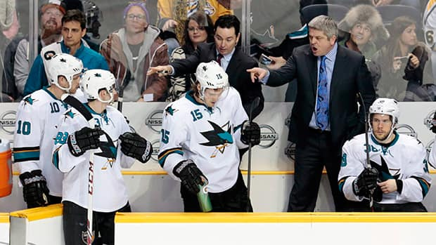 San Jose Sharks head coach Todd McLellan, top right, and assistant coach Jay Woodcroft, top center, during a game against the Nashville Predators Jan. 7, 2014, in Nashville, Tenn. (Mark Humphrey/The Associated Press)