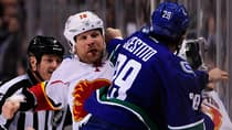 Brian McGrattan (16) of the Flames and Tom Sestito of the Canucks trade blows this past Saturday. (Anne-Marie Sorvin/Reuters)