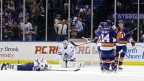 Toronto Maple Leafs goalie Jonathan Bernier (45) and defenceman Tim Gleason (8) react in an overtime loss to the New York Islanders on Thursday. (Frank Franklin II/Associated Press)