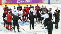 Team Canada head coach Mike Babcock, middle, holds court during practice at the Bolshoy Arena in Sochi, Russia, on Monday. (Bruce Bennett/Getty Images)