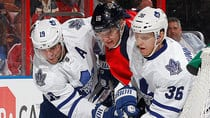 The Leafs' Joffrey Lupul, left, and Carl Gunnarsson, right, battle for control of the puck with Panthers forward Aleksander Barkov, middle, behind the net during Tuesday's game. It was one of the few times Toronto contained Florida as the Panthers fired 48 shots in a 4-1 win. (Joel Auerbach/Getty Images)